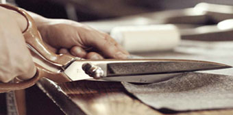 Tailor cutting cloth